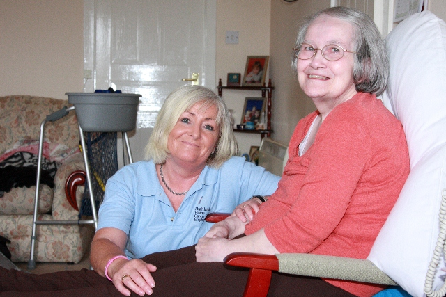 Highland Home Carers member of staff with customer