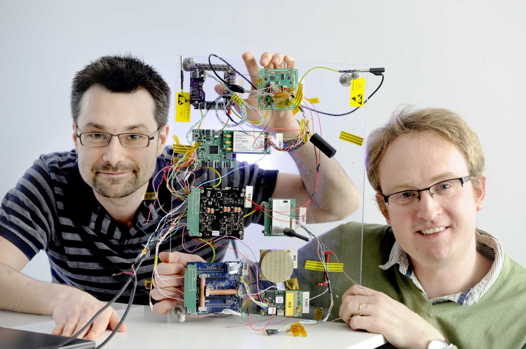 Bright Ascension company, Edinburgh, 14/03/2017: Bright Ascension founder director Peter Mendham (correct, bottom), with technical director / software engineer Mark McCram and a satellite launch control board. Photography for Cooperative Development Scotland / Scottish Enterprise from:  Colin Hattersley Photography - colinhattersley@btinternet.com - www.colinhattersley.com - 07974 957 388