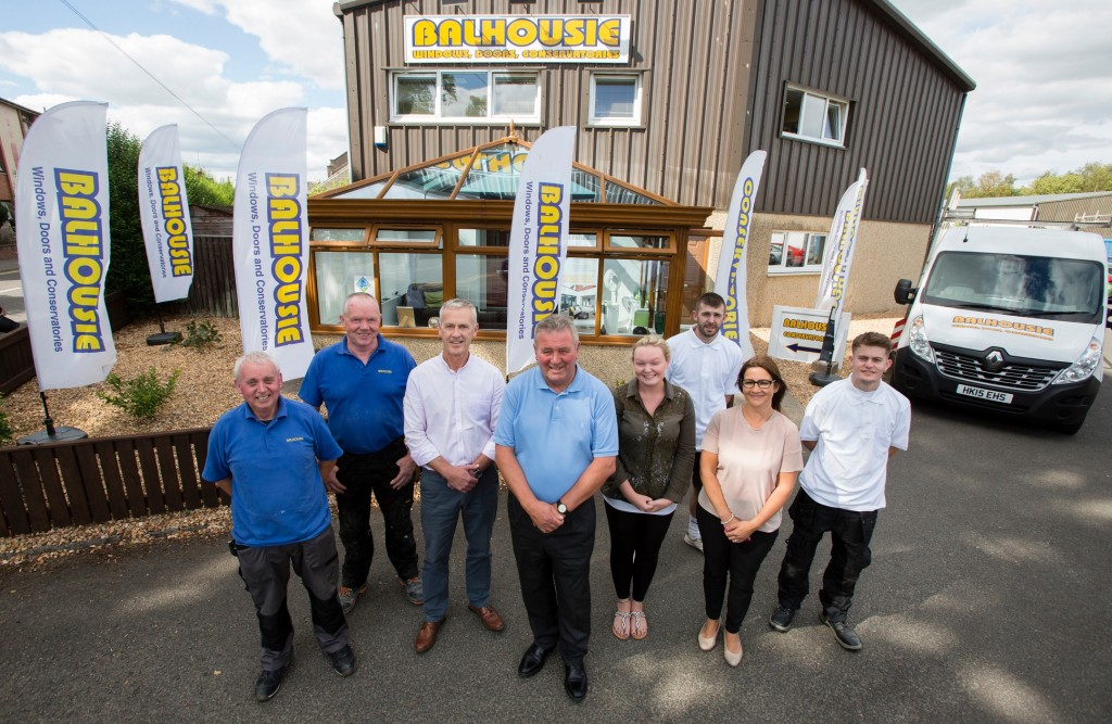 Employees and directors at Balhousie Glazing in Perth  Pictured Directors in centre Drew Hay (on left) with Malcolm Sweeney (on right) Taken 16-07-18