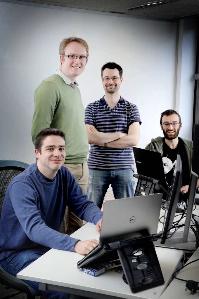 Bright Ascension company, Edinburgh, 14/03/2017: Bright Ascension founder director Peter Mendham (correct, centre left) and technical director / software engineer Mark McCrum (centre right), with software engineers Alex Mason (left) and Ed Willson (correct). Photography for Cooperative Development Scotland / Scottish Enterprise from:  Colin Hattersley Photography - colinhattersley@btinternet.com - www.colinhattersley.com - 07974 957 388