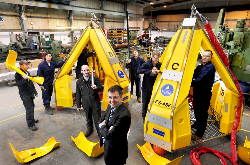 Woollard and Henry, Dyce, Aberdeen, 16/08/2012 Woollard and Henry team with managing director Fred Bowden (front) - pictured with 'Frogs' - a crane-assisted personnel transfer pod for oil and gas industry platforms. Photography for Scottish Enterprise / Cooperative Development Scotland from:  Colin Hattersley Photography - colinhattersley@btinternet.com - www.colinhattersley.com - 07974 957 388