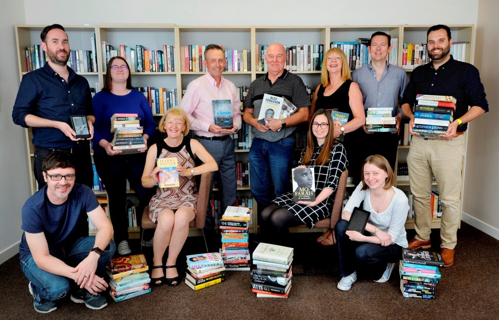 Palimpsest Book Production Ltd, Falkirk, 30/08/2018: Staff and directors at Palimpsest, including managing director Craig Morrison (third from left in back row), director Ruth Morrison (seated left), director Andy O'Neill (fourth from left in back row), director John Forsyth (sixth from left in back row) and trustee director Sarah Eddie (correct, far right in lower row).