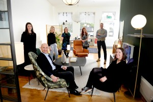 Tangram Furnishers, Jeffrey Street, Edinburgh, 28/10/2020: Founder Julian Darwell-Stone (seated front) with Sarah Ramsay (managing director, seated front) and the team in their Edinburgh Old Town showroom / office. The team are (rear, from left):  Joanne Golden (interior designer), Jenny Milne (interior designer), Tracy Innes (office manager), Melissa Mathieson (interior designer) and Wouter Bossenbroek (correct, (interior designer).